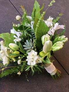 Green and white bouquet. Parrot Tulips, Freesia, Succulents, Cyclamen, Lady Slipper Orchids, Birds Nest Fern, etc etc etc!