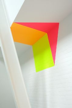 painted corner in hot neon pink, yellow and orange
