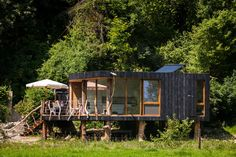tiny wooden house on stilts Wooden Cabins, Wooden House, Eco Cabin, Prefab Cabins, House On Stilts, Passive House, Green Architecture, Architecture Design, River House
