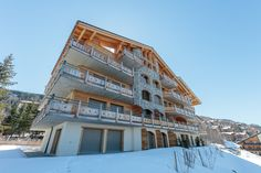 """The building """"Ferme de Sandra"""" was built in 2014 in the ski resort center in Haute-Nendaz. A few apartments are still for sale. Contact us for any question : info Ski Lift, Us Real Estate, Apartments For Sale, Public Transport, Alps, Nice View, Switzerland, Terrace, Skiing"""
