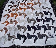So loving this cat quilt. I love the use of the negative space to also show the cat. #quilt_pins