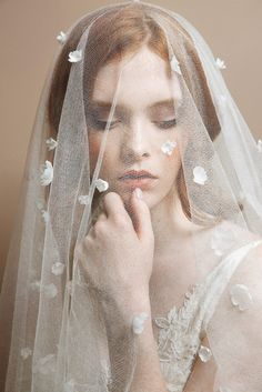 The little flowers on this veil make it so special!