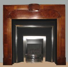 Antique Art Deco 1930s Walnut Fire SurroundAWS 04-S - Antique Art Deco 1930s Walnut Fire Surround a delightful design of the period with burr walnut panel. Can be adjusted to suit any insert.