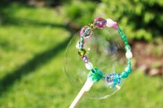 Lovely beaded bubble wands! This would be a lovely fine motor follow-up to the 'what shape is a bubble?' cognitive dissonance activity that I think should be mandatory in Pre-K!