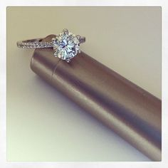 Beautiful custom engagement ring featuring a 1.10 ct. round brilliant cut diamond and thin pave diamond band.