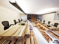 Stand, sit, or pull an Aeron chair up to a pallet/desk in the office of Amsterdam-based BrandBase. Photo: MOST Architecture