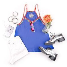 In this flatlay we styled our blue spaghetti strap top with metallic silver oxfords, white shorts, and silver bangles for the perfect summer outfit!