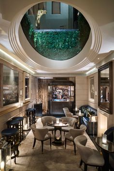 The Champagne Room at the Connaught in London -- hidden. exclusive. playhouse of titled European aristocrats.  only bar in the world that serves Krug Clos du Mesnil (2003) Champagne by the glass ($387 per glass).