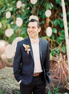 We love a groom with a sense of style! Photography by Michelle March / michellemarch.com
