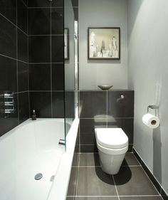 Small bath: Large tiles, monochromatic colors, sleek, glass shower doors