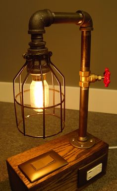 Industrial Lamp - Edison Bulb - Black Iron Pipe - Phone & Tablet Charging USB Ports - Oak Base - Metal Lamp Cage by HomeProsPlus on Etsy https://www.etsy.com/listing/208023407/industrial-lamp-edison-bulb-black-iron