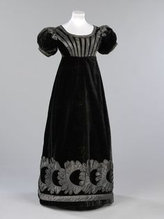 Mourning Gown | c. 1825 Fabrics such as silk and velvet were too shiny to be worn for the first stages of mourning, however, official mourning guidelines issued by the Lord Chamberlain decreed that black velvets and silks were permissible in the third and final stage. This dress would have been worn with an evening turban, long gloves and a pelisse cloak, often lined with chinchilla fur.