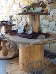 Wood reel repurposed as rustic wedding decor. Wedding Entry Table, Rustic Wedding, Fall Wedding, Wedding Ideas, Large Wooden Spools, Wood Spool, Bridal Show Booths, Industrial Wedding Inspiration, Fishing Wedding