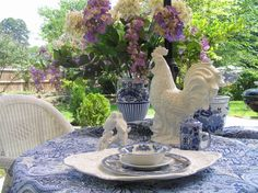 More Rooster and Mrs Hen, Here is another shot of breakfast outside with one of my collections of roosters..I love blue and white my everyda...