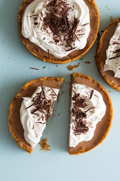 French Silk Pie Makes 3 (4 inch) pies OR 1 (9 inch) pie Ingredients: crust: 60 Nilla wafers, finely crushed 1/4 teaspoon cinnamon 3/4 cup (1 1/2 sticks) unsalted butter, melted and cooled filling: 3/4 cup superfine sugar 2 large eggs, lightly beaten 2 1/2 ounces bittersweet chocolate, melted 1/2 cup (1 stick) unsalted butter, softened 1 1/4 cup heavy whipping cream 2 teaspoons vanilla extract garnish: whipped cream, lightly sweetened shaved bittersweet chocolate