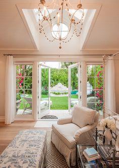 bedroom with doors that open to garden
