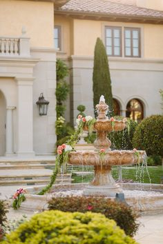 Perfect way to adorn a fountain! View the full wedding here: http://thedailywedding.com/2015/12/26/ornate-manor-wedding-lauren-adam/
