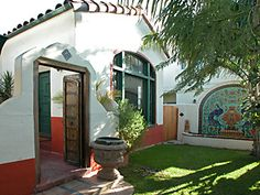 I just love the exterior wall with doors and windows!  Also a great tile mosaic with peacocks on the wall on the right.