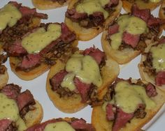 Seared Beef Tenderloin crostini with mushroom duxelle and bearnaise
