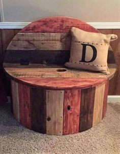 This is small yet an amazing pallet wood cable spool couch. It is perfect to be placed in small corners to increase the sitting capacity in your house. It can also be placed in your teenager's room as an interesting addition. It is a nice stool cum couch and the colored planks makes it lively. You can create extra storage space in the trunk of this stool for added value and utility.
