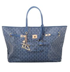 #V73 Miami Bag Big Size Blue Shop now on https://www.v73.us/borse-shopping/miami #Miami #Bag Concealed magnetic snap closure, Printed canvas, Charms shown in photo included, Metal feet at the base, Pochette inside.H: 30 CM W: 55 CM D: 16 CM