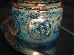 Candlelantern I made out of an old salsajar, with some blue hobbycolour, golden glitterglue, ironwire and pearls.