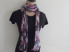 Novelty and acrylic yarns knitted lengthwise to make a super fun and colorful long scarf.