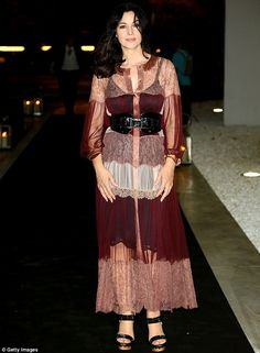 Graceful:Monica Bellucci showcased her ageless beauty once again as she attended Glamour 'n Soul opening at Museo Maxxi in Rome, Italy, on Thursday night