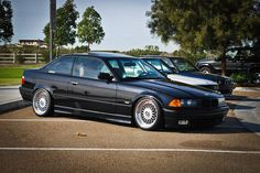 Black BMW e36 coupé Non-M bumpered on OEM BMW Styling 5 (BBS RC) wheels
