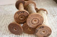 DIY spools--wooden disks, a dowel, a saw, and a drill
