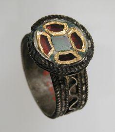 Finger Ring, Date: 6th–7th century Culture: Frankish Medium: Silver, gold foil, glass paste, filigree wire Dimensions: Overall: 7/8 x 13/16 x 9/16 in. (2.3 x 2.1 x 1.4 cm) bezel: 9/16 x 1/16 in. (1.4 x 0.2 cm)