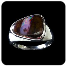 Opal Ring:Diagonal strip of pink orange opal with a spot of green. Set in sterling silver. Ref code: 5469 - suit ladies or gents fashion jewelry (jewellery)