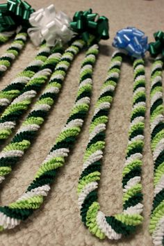 Items similar to Green and White Rick-Rack Lei with bow on Etsy Ribbon Lei, Ribbon Crafts, Hawaiian Crafts, Hawaiian Leis, Diy Arts And Crafts, Hobbies And Crafts, Graduation Leis, Graduation Stole, Flower Garland Wedding