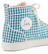 """Rantus Men's Flat  No. 1120921BLH5  THE SCOOP:  """"Rantus"""" has become a staple in the Christian Louboutin Men's Sneaker Collection. This version in blue checkered vichy fabric is ideal for the globetrotting fashionable male who understands the language of luxury."""