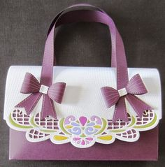 Hello bloggers!  I have asked Izzy's permission to post her gorgeous handbags on my blog and she has, not only kindly consented, but she has also written out exact directions for them with a templa