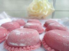 Sorrentinos rosados rellenos de zapallo y nueces.