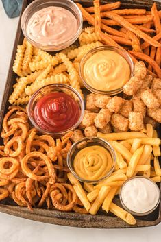 Feb 2020 - A French Fries Board is all the craze right now when it comes to entertaining. Cheese boards are out and fries boards are in. A sheet plan loaded with a variety of french fries and I Love Food, Good Food, Yummy Food, Fun Food, Healthy Food, Appetizer Recipes, Snack Recipes, Cooking Recipes, Appetizers