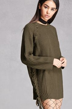 892f60767a A ribbed knit oversized sweater featuring a lace-up side