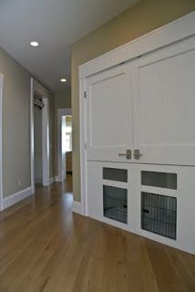Built-in kennels under the coat closet of the rear entry for the two canines of the home.