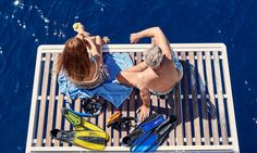 Relax after a snorkeling adventure aboard a yacht from Sunset Oia Sailing Cruises