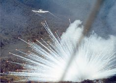 A U.S. Air Force Douglas A-1E Skyraider drops a white phosphorus bomb on a Viet Cong position in South Vietnam in 1966. #