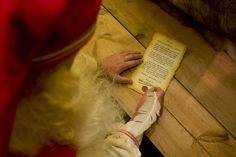 Father Christmas writing an invite