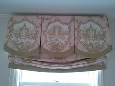 Shaped box-pleat valance with contrasting banding and inserts along with banded relaxed roman shade