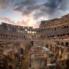 Inside the Colosseum in Rome at sunset with City Wonders.