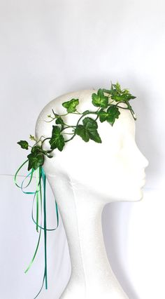 My latest design here I have made a poison ivy accessory, tree people or mother nature festival fancy dress Ivy Halo crown, I have made on a lattice base crown with loops at the back of the head with ribbons to tie, ivy foliage leaves weaved through the design, at the front I have designed a triple loop thats sits on the forehead with a multi facited bead sitting within the bottom loop I can make with different coloured beads if you wish.  ORDERING Pick from the drop down list above which…