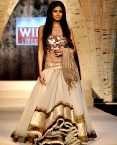 Shilpa Shetty in a copper and gold lengha choli by Arshiya Fakih