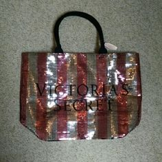 NWT Victoria's Pink & Silver Secret Sequin Tote Brand new, never used, still in plastic and has original tag. Zipper enclosure. Very spacious bag. Pink and silver sequins with black logo on front. Back is black Victoria's Secret Bags Totes