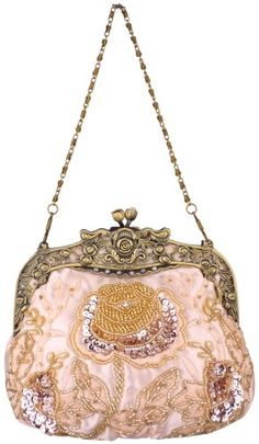 Vintage purse. i love finding and adoring these at old antique stores, imagining how ladylike and classy the woman who first carried it must have been
