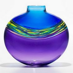 The gracefully flowing shape and bold rainbow-hued colors make this vase a breathtaking addition to any room.