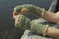 knitted mittens . The color of grass . Ancient Peruvian pattern . Cotton wool acrylic